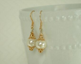 Ivory Hemalyke Dangle Drop Beaded Earrings in Gold