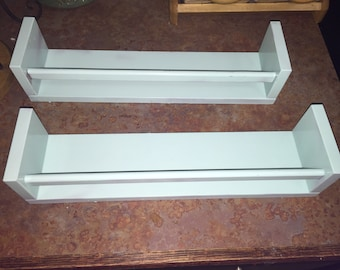 Set of two hand painted light blue shelves.
