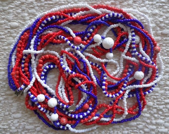 Necklace in the colours white, red and blue,