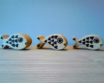 Set of 3 hand crafted solid wood Fish.