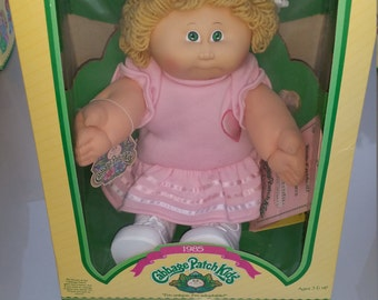 Cabbage Patch kid blonde with pink dress and paperwork Mint in box 1985