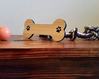 Dog Bone Sign With Paw Prints