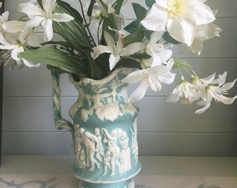 Teal and Cream Ceramic Pitcher with Raised Relief Design