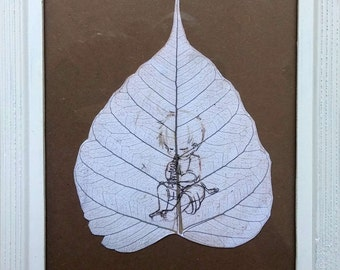 framed litograph printed on dry leaf chiked play a flute