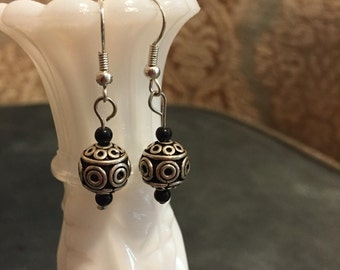 Silver and black patterned earrings
