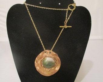 Broze pendant with natural jade