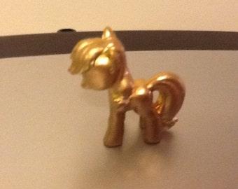 Gold painted applejack pony