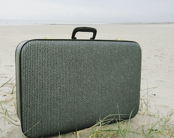 Vintage travel suitcase with retro pattern from the sixties or seventies