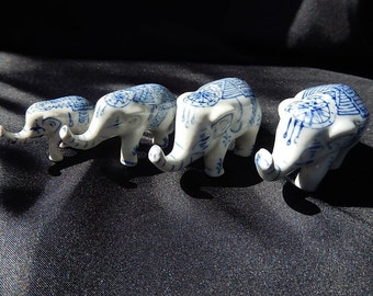 Chinese porcelain elephants.