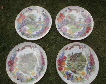 four bone china plates depicting english & dutch scenes