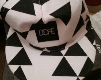 white and black baseball hat