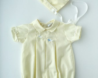 Light yellow baby romper and bonnet