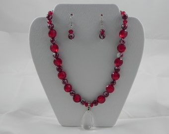 Red and white glass beaded necklace with clear glass pendant and earring set