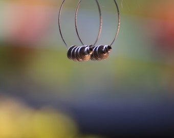 Ripples and Shine -hoop earrings, light