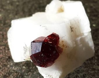 Gemmy Spessartine Garnet Crystal on Matrix. From Shengus, Pakistan. (Item # g00020)
