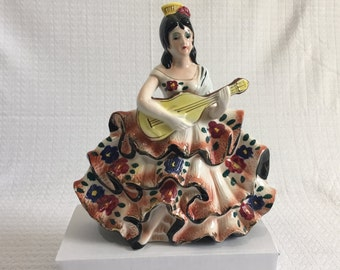 Latin Lady Sitting on stool with Yellow Mandolin in Floral Dress