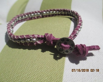 Leather purple wrap bracelet with silver beads.