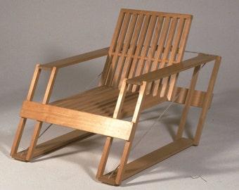 Contemporary folding armchair in beech