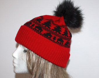 Red with black winter Christmas trees and faux pompom beanie hat