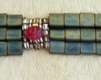 Loomed matte green tila bracelet