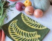 gold and green batik tea towel