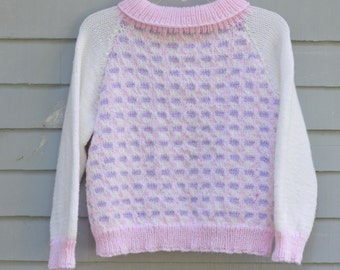 Girl, size 7/8, Turtle neck sweater in pink, lavender and white.