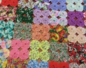 "YoYo quilt. 26"" by 19"" multicolors"