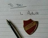 I Adulted Today enamel shield merit badge