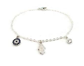 Tiny hamsa, evil eye and cubic zircona sterling silver bracelet