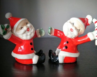 Vintage Set of 2 Napco Christmas Ceramic Santa Claus Candle Climbers or Candle Huggers Candy Cane