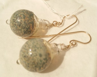 Silver grey earrings on gold wires