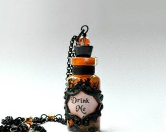 Alice in Wonderland Orange and Black Drink Me Bottle Pendant