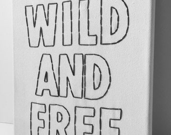 Wild and free hand embroidered wall hanging. Embroidered canvas.