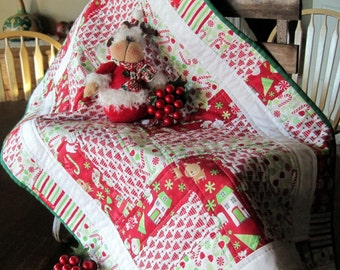"""Holiday table runner in Riley Blake fabrics. Quilted. Red, white and green.  19"""" x 31""""."""