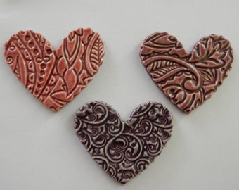 3 large embossed ceramic hearts with scalloped edges