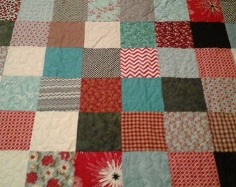 Twin size red,turquoise,  black and gray quilt