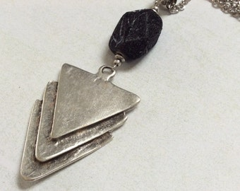 Triple triangle antique plated silver pendant necklace. Black lucite nugget.