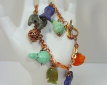 Bracelet with Afghan Handmade Animal Beads including Lion, Fish, Elephant and Turtles and Gold Washed Torched Copper
