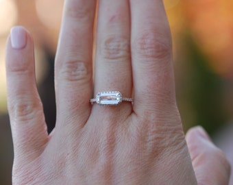Baguette engagement ring. 1.09ct rectangular emerald cut white sapphire 14k rose gold diamond ring. Engagement ring by Eidelprecious.