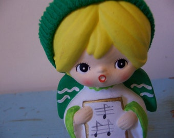 little ceramic angel with a knit cap