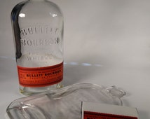 A flattened recycled Bulleit Bourbon bottle glass cutting board with recycled label coaster. Fused Whiskey bottle tray