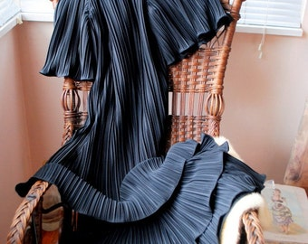Flapper style vintage 80s black polyester,fortuny pleats with a three tieres  dress. Made by Cora's Closet. Size S-M.