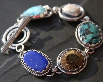 RESERVED for Carol oOo lapis lazuli, ammonite, turquoise, fossil sand dollar, larimar, and sterling silver metalwork link bracelet