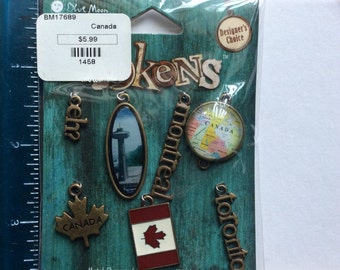 Blue Moon Tokens Canada gold toned metal charms