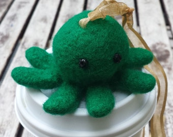 Green octopod on hanging loop