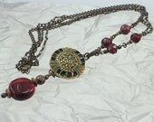 Antique Button Necklace - Brass chain with deep red colors