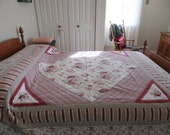 Reduced....Nice queen size quilt in red, white, rose floral mixed pattern- red gingham backing- weighty, warm, nice condition