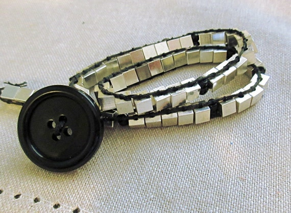 This silver and black sciart physics wrap bracelet would be a great gift for physics teacher, grads, and fans.