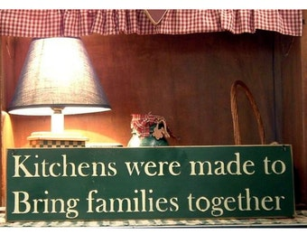 Kitchens were made to keep families together primitive wood sign
