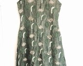 Amazing womens green beaded sari tunic with gold embroidery and green beading side slits
